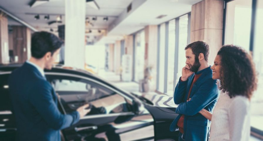 Couple Picking a New Vehicle at Dealership