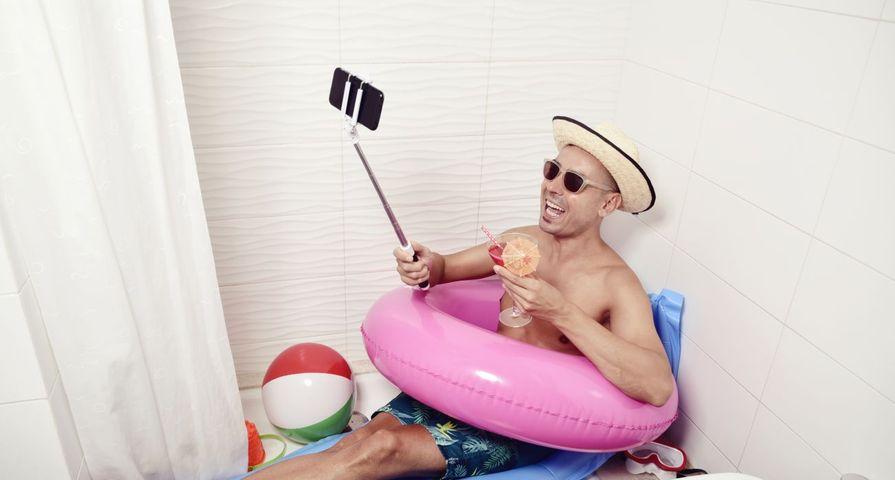 Man Taking Selfie Enjoying Staycation