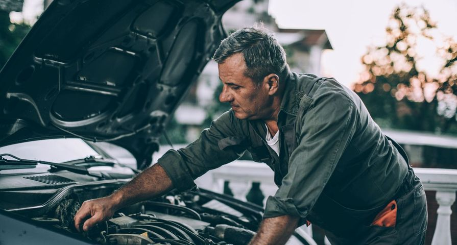 Man Working on His Own Car Engine
