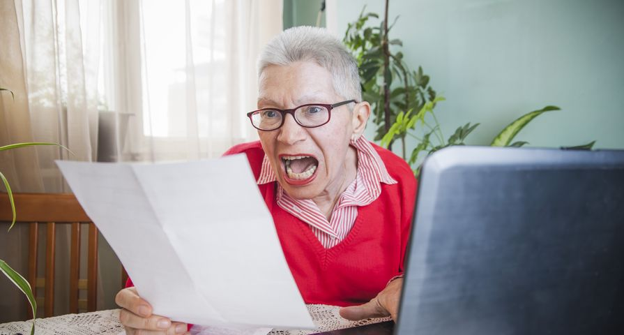 Woman Yelling While Looking at Bill