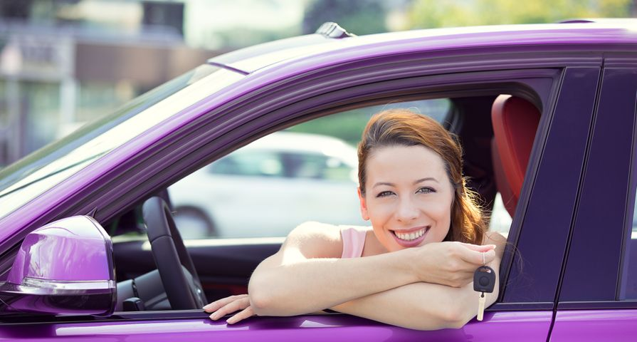 Woman Excited with New Purple Car