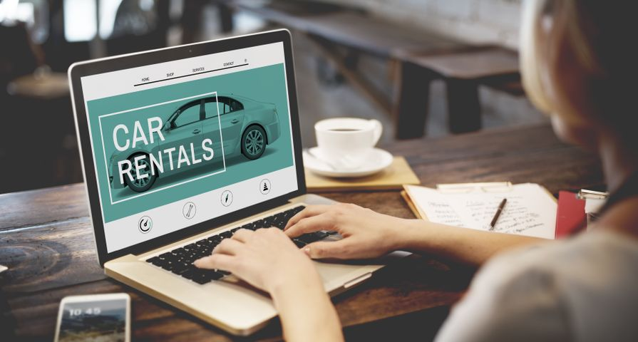 Woman Looking at Car Rental Website