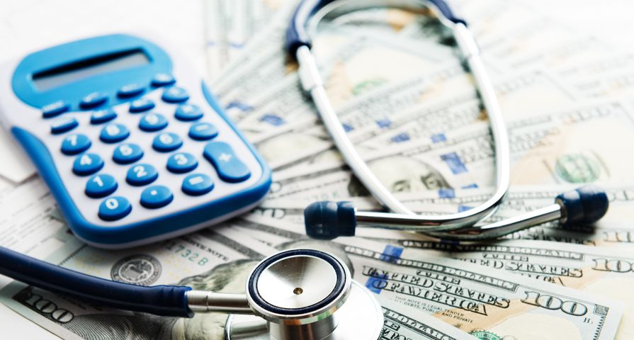 Money with Healthcare Stethoscope & Calculator