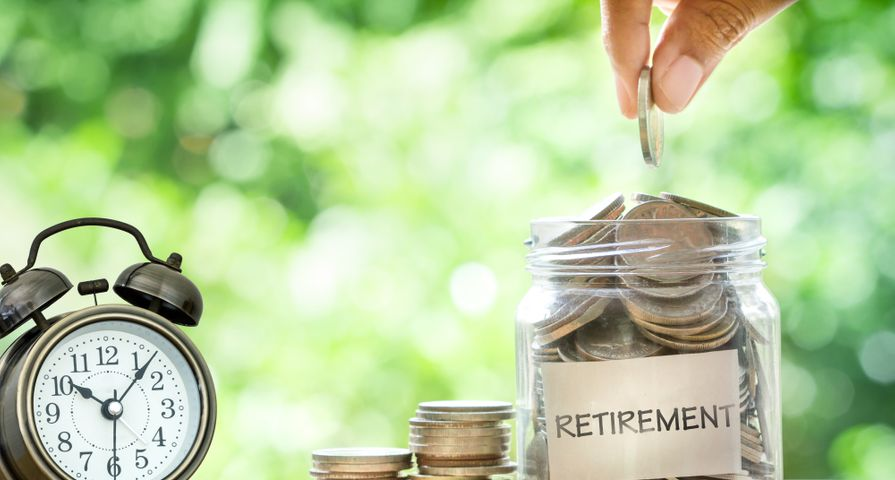 Saving Coins for Retirement in Jar
