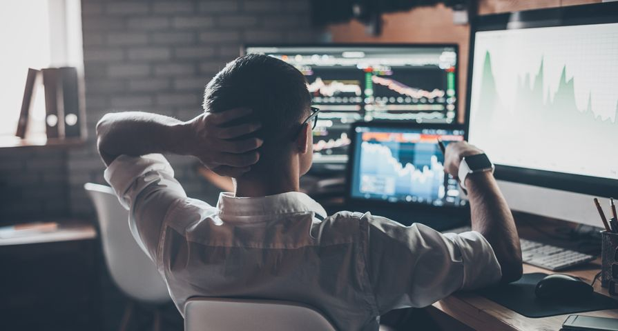 Man Alone Investing on Computer