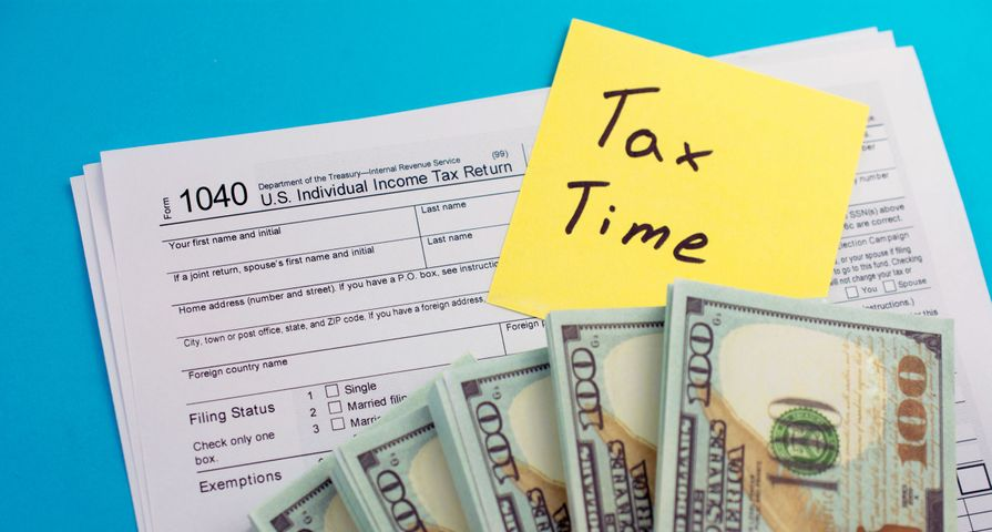 Tax Form 1040 Under Cash Stacks
