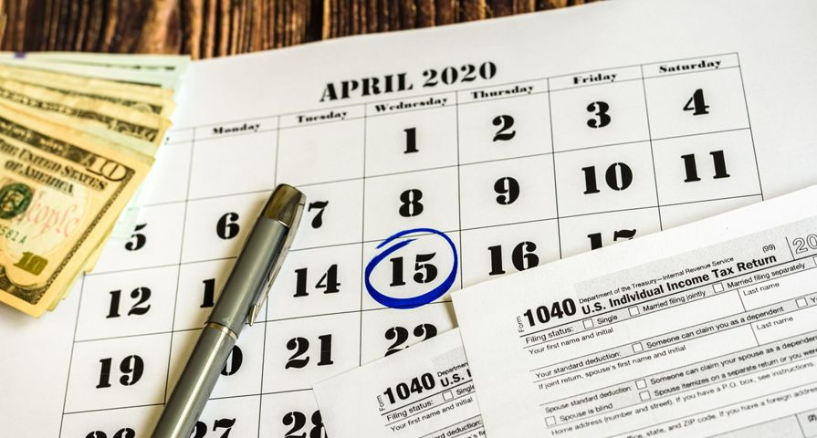 April 15th Circled on Calendar with Tax Forms