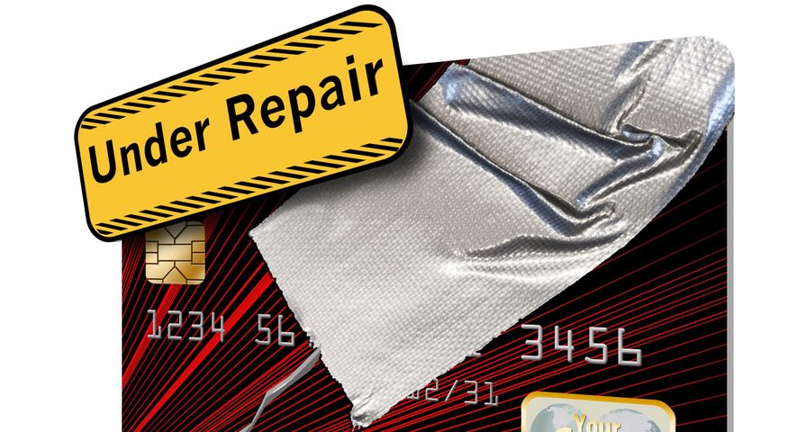 Credit Card Taped with Under Repair Sign
