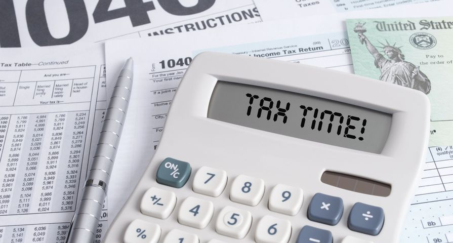 Tax Forms with Calculator that Says Tax Time