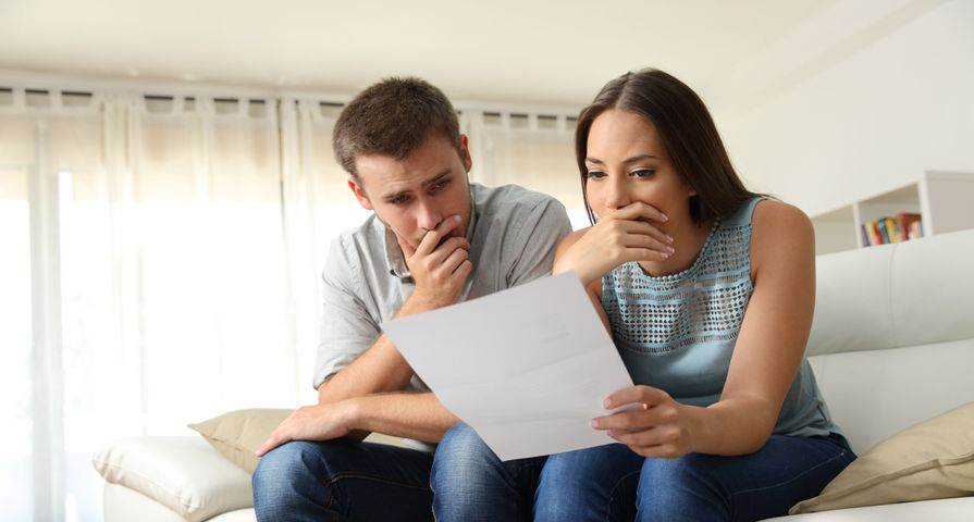 Couple Studying Bankruptcy Documents