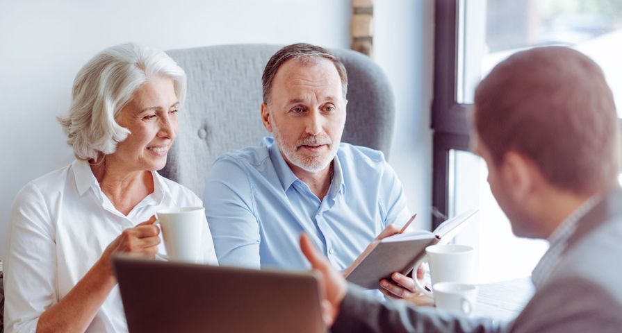 Older Couple Discussing Finances with Advisor