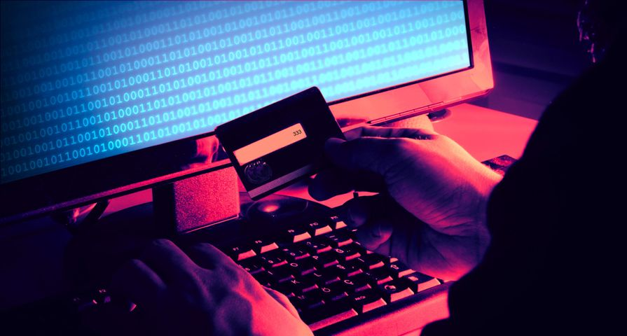 Hacker Stealing Credit Card Identity
