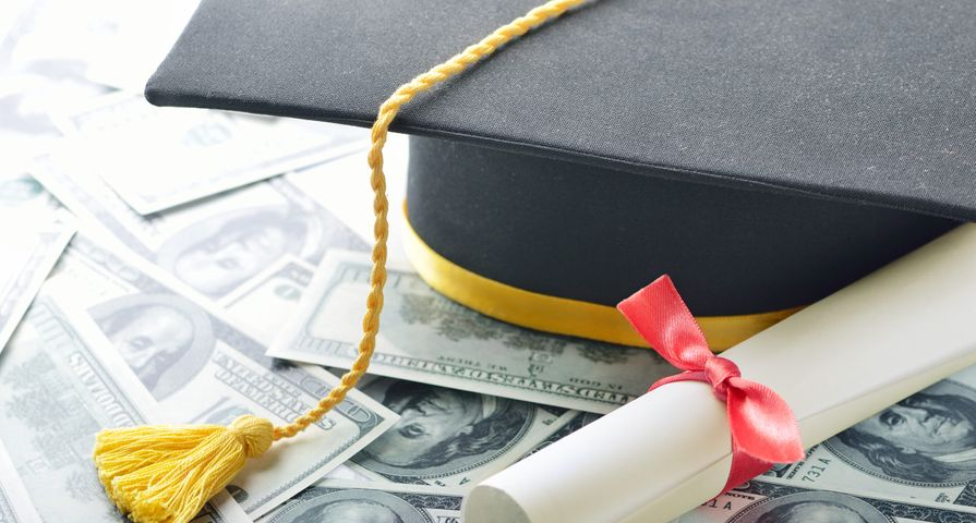 Student Graduation Cap on Top of Money