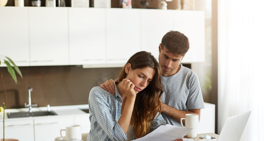 Couple Considering Debt in Kitchen