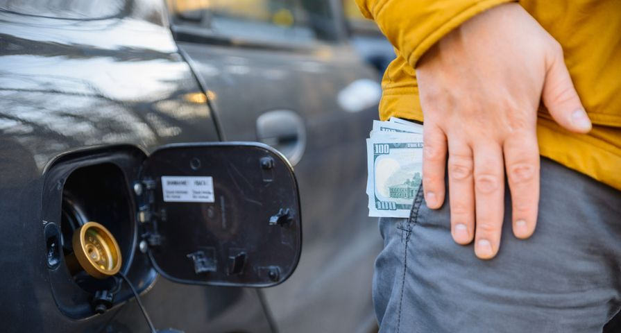Cash in Pocket by Car Gas Cap
