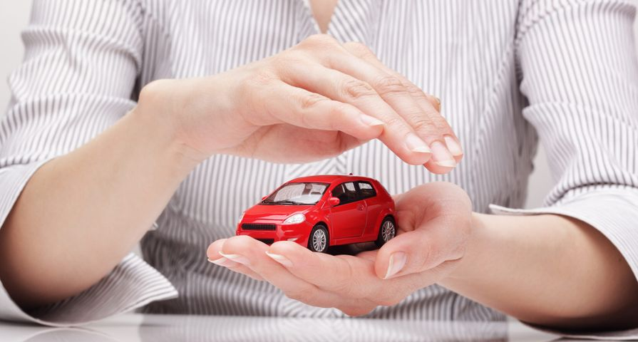 Woman Holding Mini Red Car