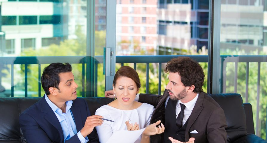 Woman Ignoring Business Men's Advice
