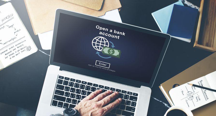 Man Opening Bank Account on Laptop