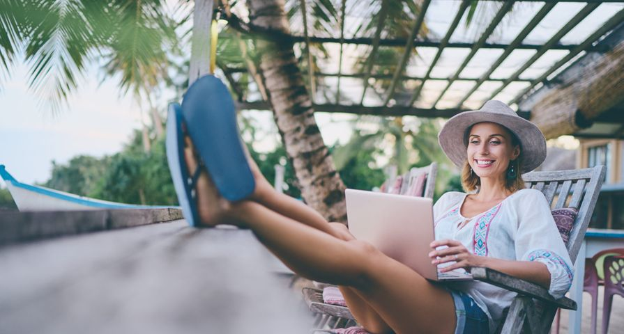 Woman Relaxing on Vacation with Laptop